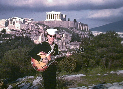 Dan with guitar near the Acropolis